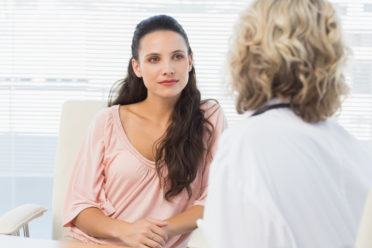 Young woman listening to doctor