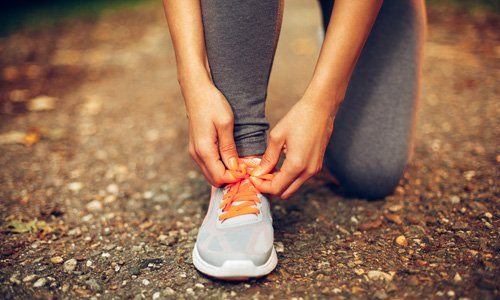 woman-tying-running-shoe-500